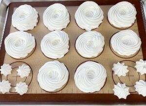 Baking sheet with the meringue nests