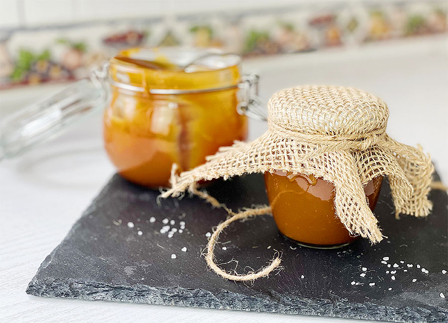 Caramel sauce inside of little jar decorated with twine